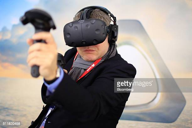 An attendee tries the Vive virtual reality experience on the HTC Corp stand at the Mobile World Congress in Barcelona Spain on Tuesday Feb 23 2016...