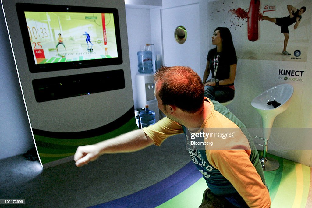 Fitness game using the Kinect device on Microsoft Corp.'s Xbox 360 gaming console during the Electronic Entertainment Expo (E3) in Los Angeles, California, U.S., on Wednesday, June 16, 2010. Microsoft Corp., looking to boost profit and sales in its Xbox video-game unit, plans to start selling the motion-controlled Kinect device on Nov. 4, allowing console users direct action by moving their bodies. Photographer: Jonathan Alcorn/Bloomberg via Getty Images