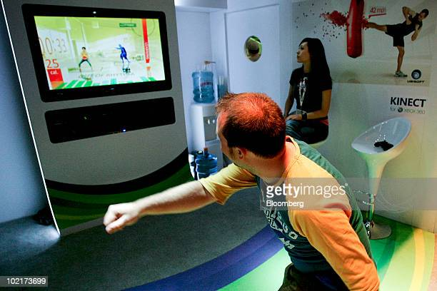 An attendee tries the Your Shape: Fitness game using the Kinect device on Microsoft Corp.'s Xbox 360 gaming console during the Electronic...