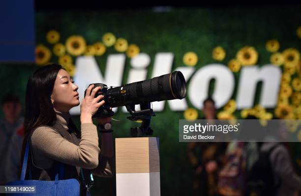 An attendee uses a DSLR camera in the Nikon booth during CES 2020 at the Las Vegas Convention Center on January 7, 2020 in Las Vegas, Nevada. CES,...