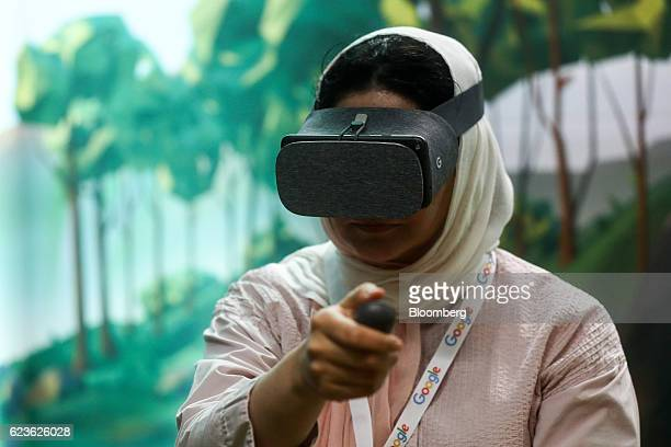 An attendee uses a Google Inc Daydream View virtual reality headset during an event at Google's Kings Cross office in London UK on Tuesday Nov 15...