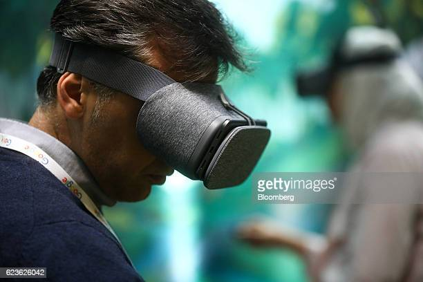 f60103a70b9 An attendee uses a Google Inc Daydream View virtual reality headset during  an event at Google s