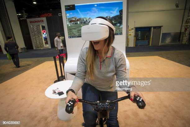 An attendee uses a Huawei Technologies Co VR2 virtual reality headset during the 2018 Consumer Electronics Show in Las Vegas Nevada US on Thursday...
