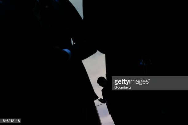 An attendee uses a mobile device on the second day of Mobile World Congress in Barcelona, Spain, on Tuesday, Feb. 28, 2017. A theme this year at the...
