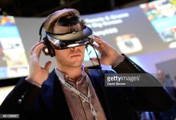 An attendee uses a Sony Head Mounted Display at the Sony booth at the 2014 International CES at the Las Vegas Convention Center on January 7 2014 in...