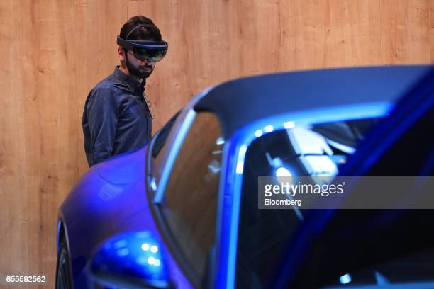 An attendee uses a Virtual Reality headset fitted with augmented reality vision tracking software by VisionLib to view the internal workings of a...