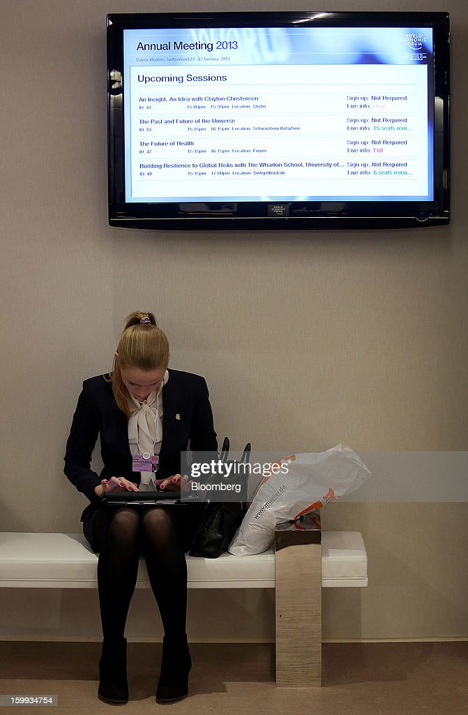 An attendee uses an Apple Inc. iPad in between sessions on the opening day of the World Economic Forum (WEF) in Davos, Switzerland, on Wednesday, Jan. 23, 2013. World leaders, Influential executives, bankers and policy makers attend the 43rd annual meeting of the World Economic Forum in Davos, the five day event runs from Jan. 23-27. Photographer: Chris Ratcliffe/Bloomberg via Getty Images