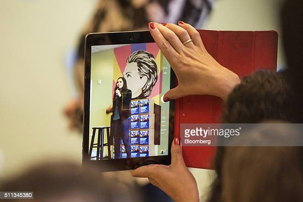 An attendee uses an Apple Inc iPad to take a photograph of actress America Ferrera as she speaks during a campaign event at a campaign office for...
