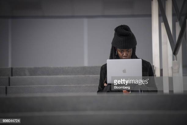 An attendee uses an Apple Inc laptop computer during the Game Developers Conference in San Francisco California US on Wednesday March 21 2018 The GDC...