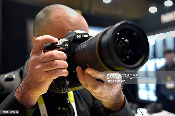 An attendee uses the Nikon D5 DSLR camera at the Nikon booth at CES 2016 at the Las Vegas Convention Center on January 6, 2016 in Las Vegas, Nevada....