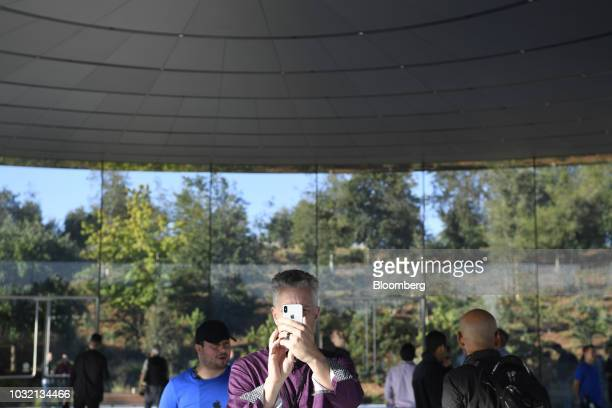 An attendee views an Apple Inc iPhone ahead of an event at the Steve Jobs Theater in Cupertino California US on Wednesday Sept 12 2018 Apple will...
