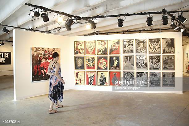 An attendee views artwork at The Dean Collection X BACARDI No Commission Art Fair Day 1 on December 3 2015 in Miami Florida