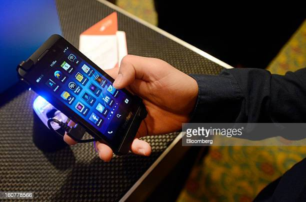 An attendee views the BlackBerry Z10 device during an event at the Empire Club of Canada in Toronto Ontario Canada on Tuesday Feb 5 2013 Thorsten...