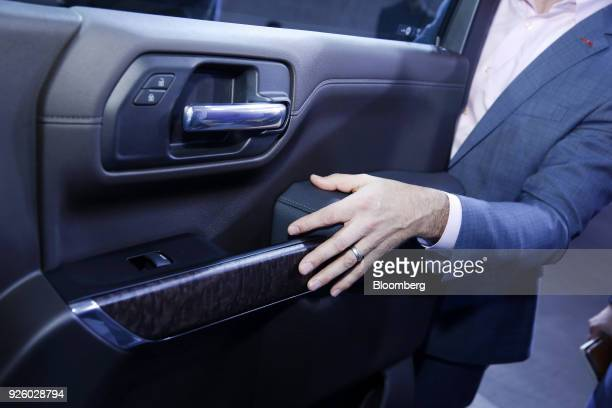 An attendee views the door interior of the General Motors Co 2019 GMC Sierra Denali truck during an event at Russell Industrial Complex in Detroit...