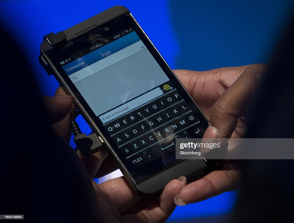 An attendee views the new BlackBerry 10 during the device's launch in New York, U.S., on Wednesday, Jan. 30, 2013. Research In Motion Ltd. (RIM), taking the name of its best-known product, will now be known simply as BlackBerry, part of a comeback plan that includes unveiling a redesigned line of smartphones today. Photographer: Scott Eells/Bloomberg via Getty Images