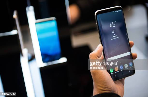 An attendee views the Samsung Electronics Co Galaxy S8 smartphone displayed during the Samsung Unpacked product launch event in New York US on...