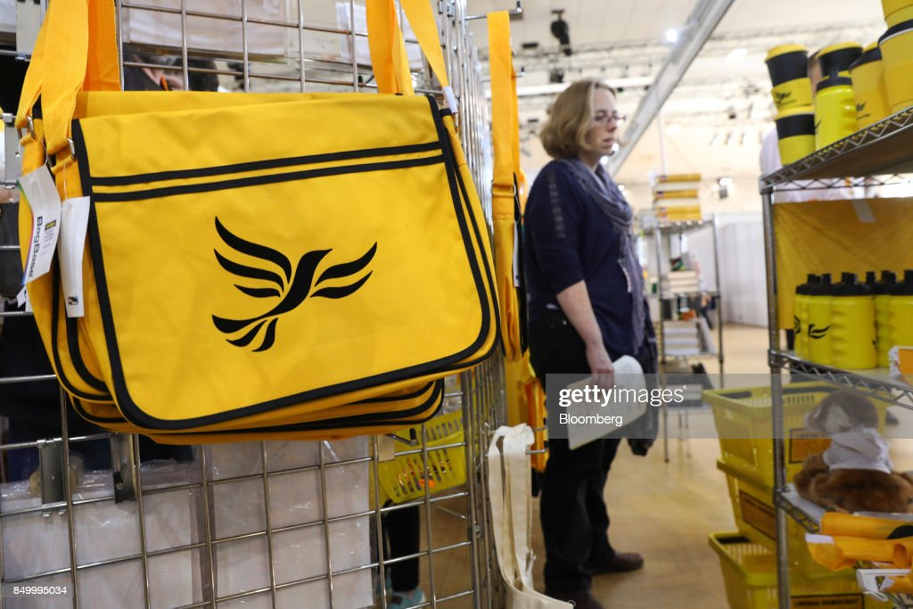 An attendee views U.K.'s Liberal Democrat Party branded merchandise on sale at the party's annual conference in Bournemouth, U.K., on Tuesday, Sept. 19, 2017. Cable said U.K. Prime Minister Theresa May should fire her foreign secretary, Boris Johnson, over an article he published on Saturday about Britains departure from the European Union. Photographer: Luke MacGregor/Bloomberg via Getty Images