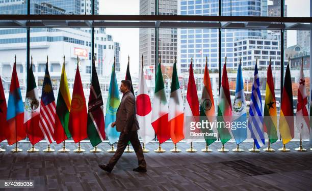 An attendee walks by flags of participating United Nation countries during the 2017 UN Peacekeeping Defence Ministerial conference in Vancouver...
