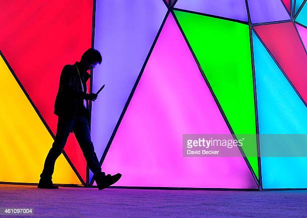 An attendee walks by the TCL booth during the 2015 International CES at the Las Vegas Convention Center on January 6 2015 in Las Vegas Nevada CES the...
