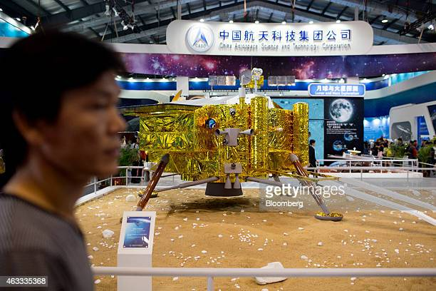 An attendee walks past a China Aerospace Science and Technology Corp Chang'e 3 lunar lander during the China International Aviation Aerospace...
