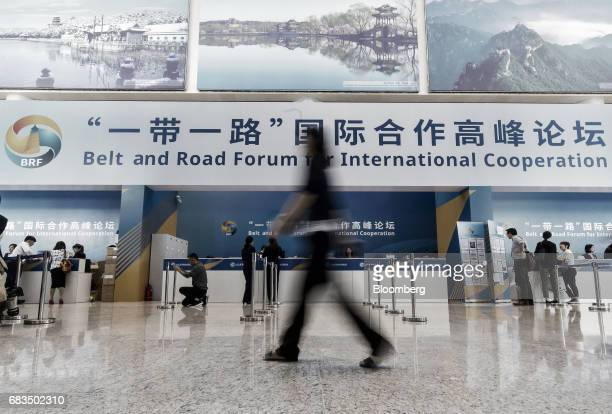 An attendee walks past registration counters at the media center for the Belt and Road Forum For International Cooperation at the National Convention...