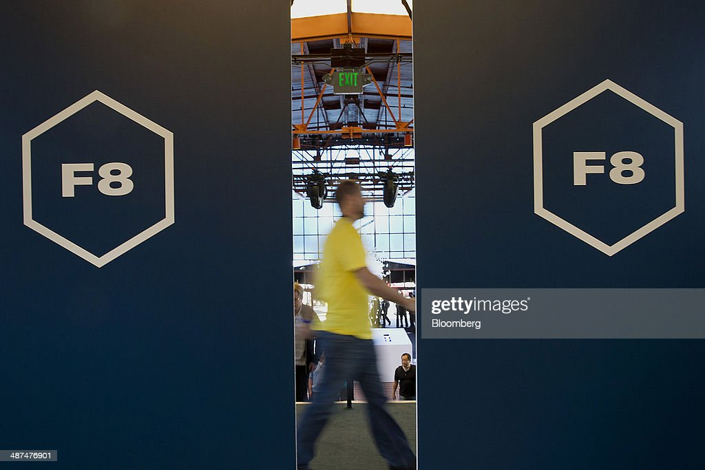 An attendee walks past signage at the Facebook F8 Developers Conference in San Francisco, California, U.S., on Wednesday, April 30, 2014. Facebook Inc. will offer software developers improved tools to create programs that run on any smartphone and a more streamlined experience for people to log into apps, including the option to sign in anonymously. Photographer: Erin Lubin/Bloomberg via Getty Images