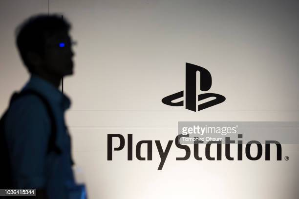 An attendee walks past the PlayStation logo in the Sony Interactive Entertainment booth during the Tokyo Game Show 2018 on September 20, 2018 in...