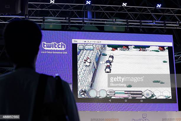 An attendee watches a live demonstration of Link Kit Inc's Snow World online game displayed in a Twitch Interactive Inc's streaming video service in...