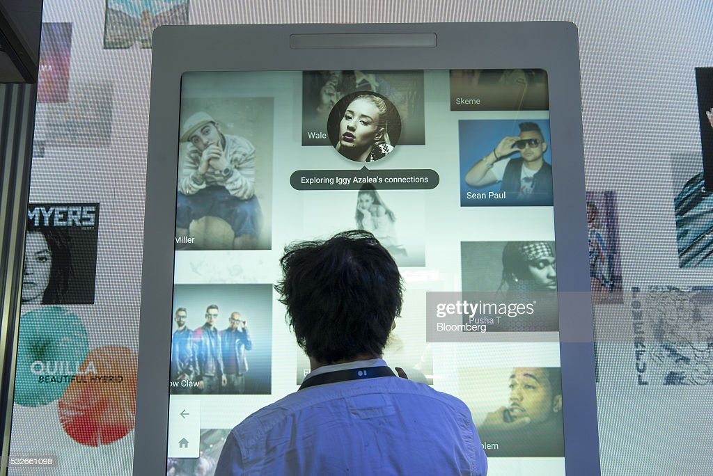 An attendee watches a presentation during the Google I/O Annual Developers Conference in Mountain View, California, U.S., on Wednesday, May 18, 2016. Google unveiled a new video calling application named Duo that will compete with Apple Inc.'s FaceTime. Photographer: David Paul Morris/Bloomberg via Getty Images