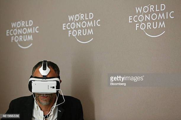 An attendee watches an immersive 3D movie on a Samsung Gear VR virtual reality headset manufactured by Samsung Electronics Co on day two of the World...