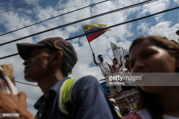 An attendee waves a flag during the closing campaign rally for Evangelical pastor Javier Bertucci presidential candidate for the Esperanza Por El...