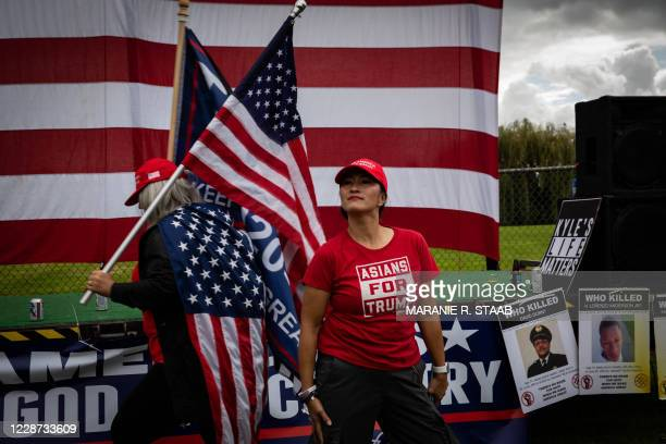 """An attendee wearing a """"Asians For Trump"""" shirt stands as several hundred members of the Proud Boys and other similar groups gathered for a rally at..."""
