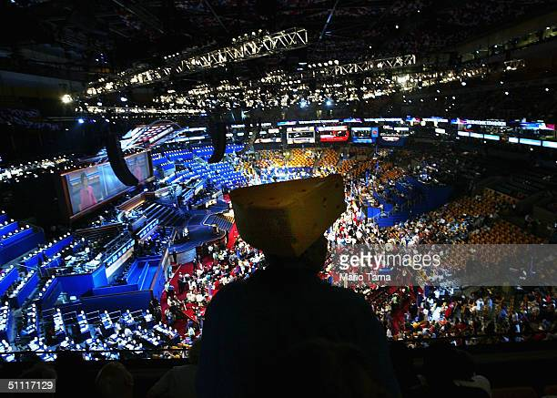 An attendee wearing a cheesehead hat watches events at the Democratic National Convention at the FleetCenter July 26 2004 in Boston Massachusetts...