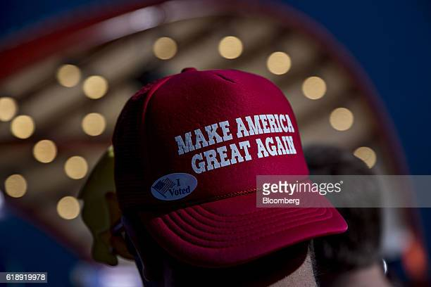 An attendee wearing a hat reading 'Make America Great Again' waits for the arrival of Donald Trump 2016 Republican presidential nominee during a...