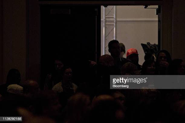 An attendee wearing a Make America Great Again hat walks into the general session hall during the Conservative Political Action Conference in...