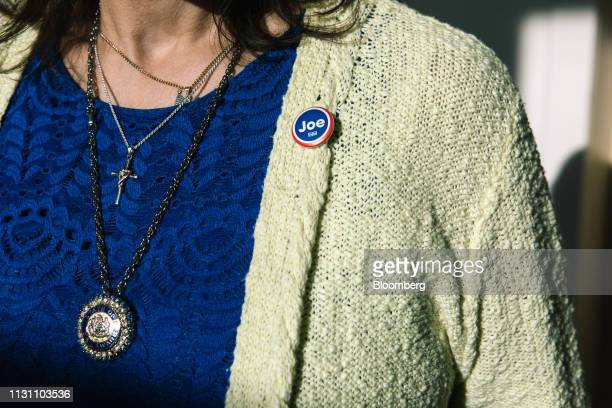 An attendee wears a button featuring former US Vice President Joe Biden during the first State Democratic dinner in Dover Delaware US on Saturday...