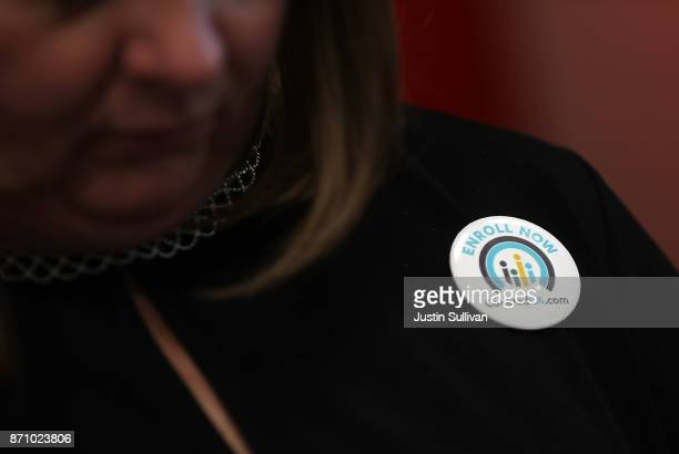 An attendee wears a button promoting open enrollment with Covered California during a news conference at HealthRIGHT 360 on November 6 2017 in San...