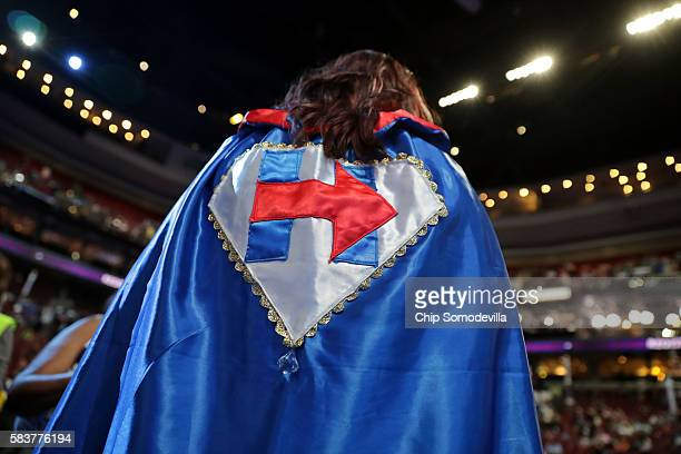 An attendee wears a cape in support of Democratic presidential candidate Hillary Clinton before the start of the third day of the Democratic National...