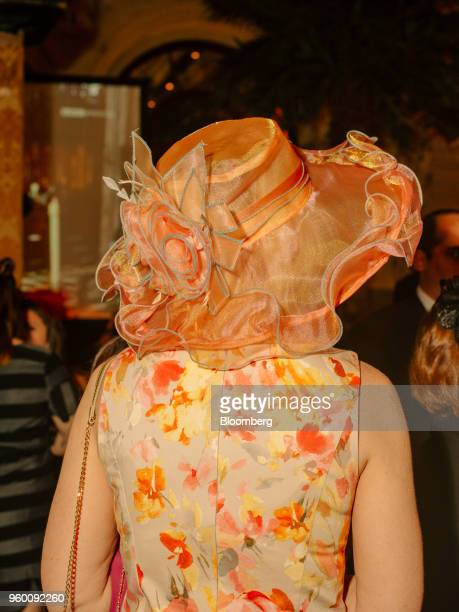 An attendee wears a floral dress and decorative hat during a royal wedding viewing party at the Plaza Hotel in New York US on Saturday May 19 2018...
