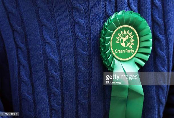 An attendee wears a Green Party rosette during a news conference in London UK on Tuesday May 2 2017 Five weeks before the general election local...