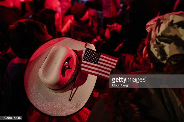 An attendee wears a hat displaying an American flag during a campaign rally outside the Historic Yavapai County Courthouse in Prescott Arizona US on...
