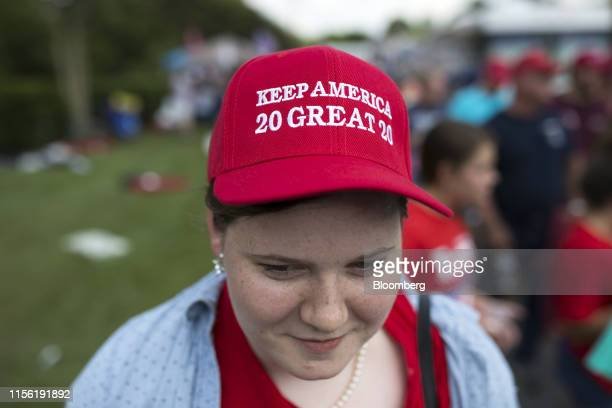 """An attendee wears a hat that reads """"Keep America Great 2020"""" ahead of a rally with U.S. President Donald Trump, not pictured, in Greenville, North..."""