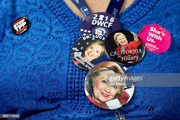 An attendee wears a hat with campaign memorabilia prior in support of Democratic presidential candidate Hillary Clinton before the start of the third...