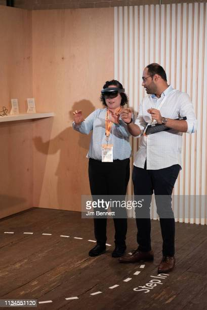 An attendee wears a Hololens headset while a staff person discusses the experience with her at the LinkedIn Studio at Brazos Hall during SXSW on...