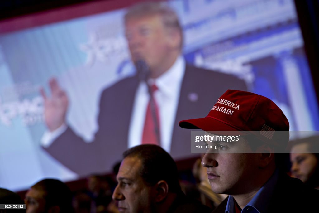 An attendee wears a 'Make America Great Again' hat as U.S. President Donald Trump speaks at the Conservative Political Action Conference (CPAC) in National Harbor, Maryland, U.S., on Friday, Feb. 23, 2018. The list of speakers at CPAC includes two European nativists who are addressing the gathering between panels and events on the dangers of immigration, Sharia law and lawless government agencies. Photographer: Andrew Harrer/Bloomberg via Getty Images