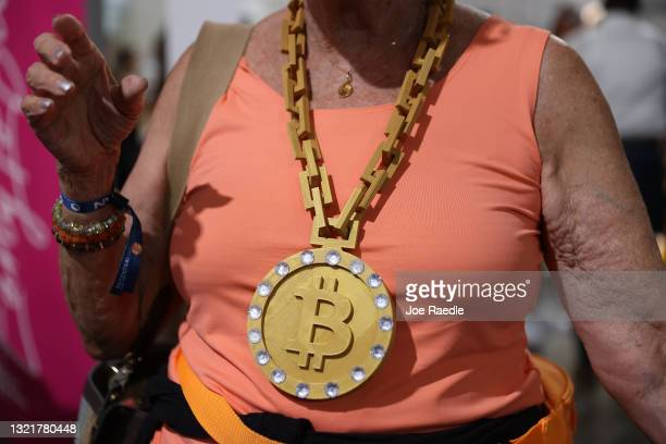 An attendee wears a necklace at the Bitcoin 2021 Convention, a crypto-currency conference held at the Mana Convention Center in Wynwood on June 04,...