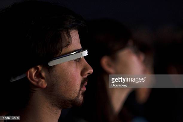 An attendee wears a pair of Google Glass connected glasses while listening to a speaker on day three of the Mobile World Congress in Barcelona,...