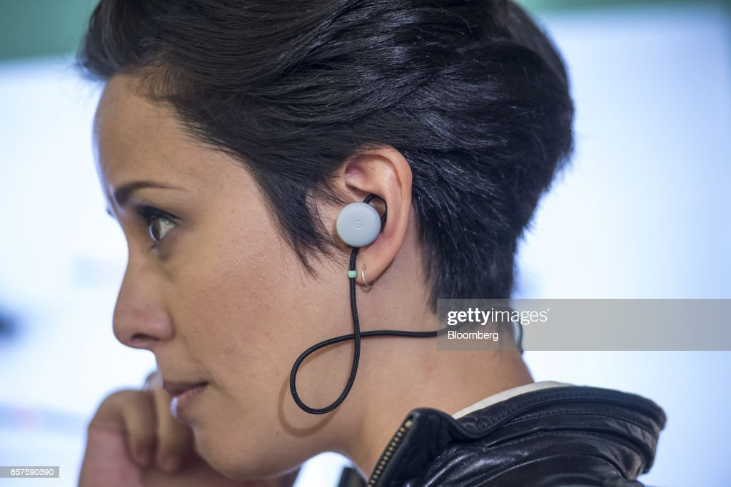 An attendee wears a pair of Google Inc. Pixel Buds wireless headphones during a product launch event in San Francisco, California, U.S., on Wednesday, Oct. 4, 2017. Google unveiled the second generation of its own devices along with an array of entirely new gadgets, plowing the company deeper into a competitive consumer hardware market. Photographer: David Paul Morris/Bloomberg via Getty Images