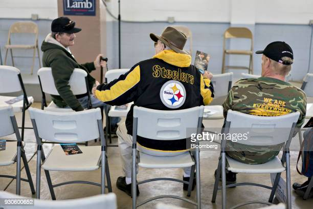 An attendee wears a Pittsburgh Steelers branded jacket before a campaign rally for Conor Lamb Democratic candidate for the US House of...