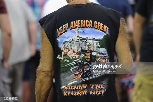 An attendee wears a shirt depicting US President Donald Trump and adult entertainment star Stormy Daniels at a campaign rally at the Ford Center on...